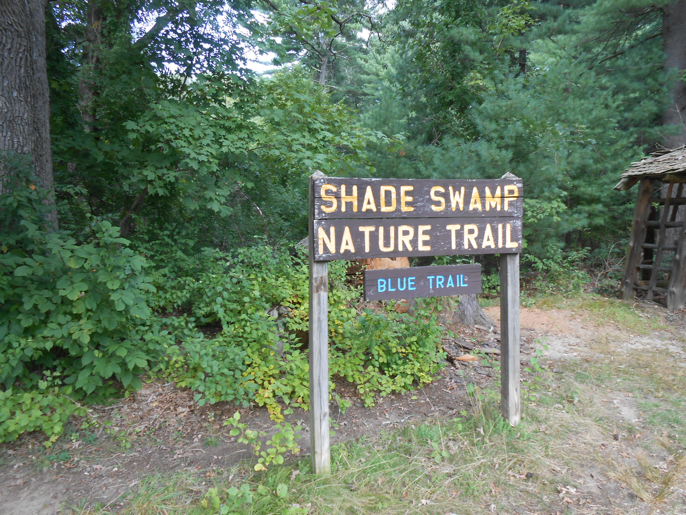 Shade Swamp Nature Trail sign in parking area